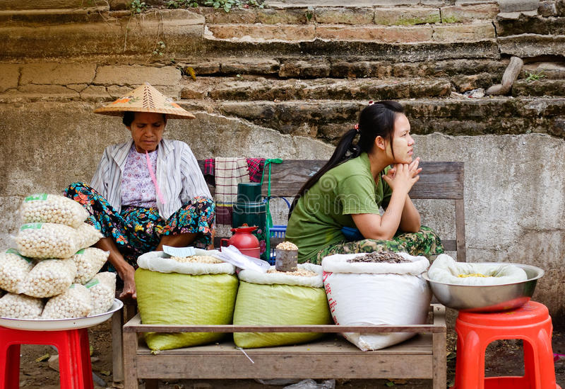Burmese women selling street foods in Mandalay, Myanmar.  royalty free stock photo