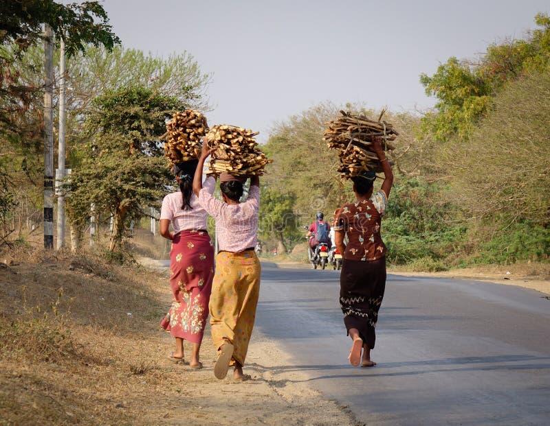 Burmese women walking on road in Inle, Myanmar.  royalty free stock photography