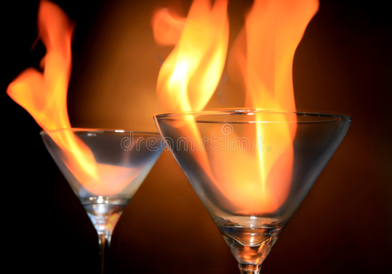 Burn. Two cocktails with fire on white background royalty free stock images