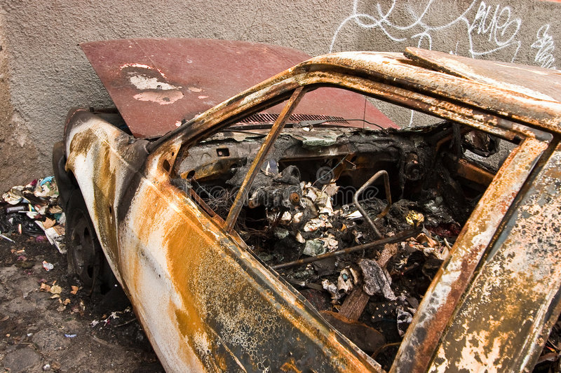 Burned. A burned car parket in the outskirt of Rome, Italy royalty free stock photo