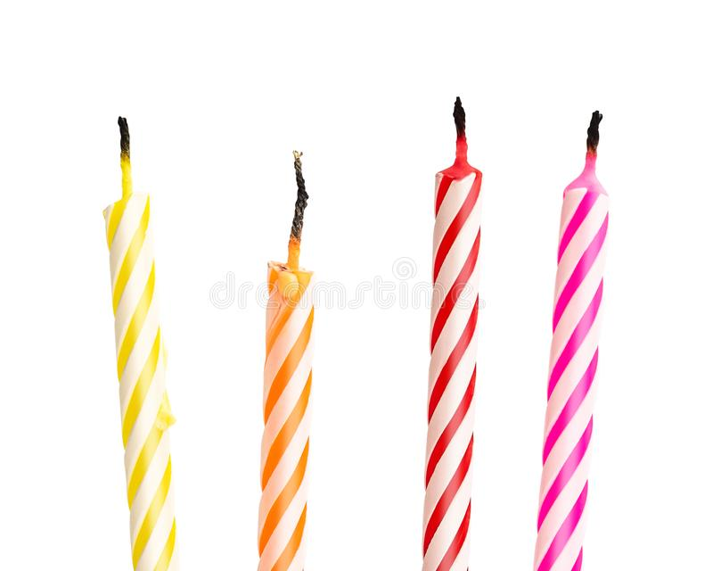 Burned birthday candles isolated on white background. Colorful collection. Clipping path royalty free stock photography