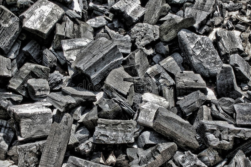 Burned Black Wood Charcoal Pieces Background stock photography