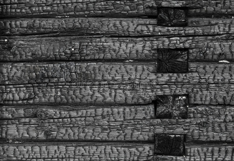 Burned black wooden wall stock photo