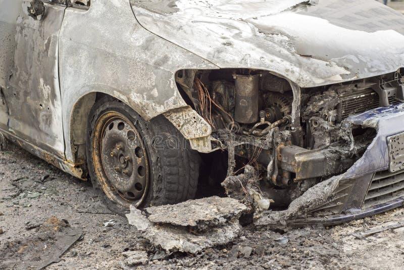 Burned car in the street stock photos