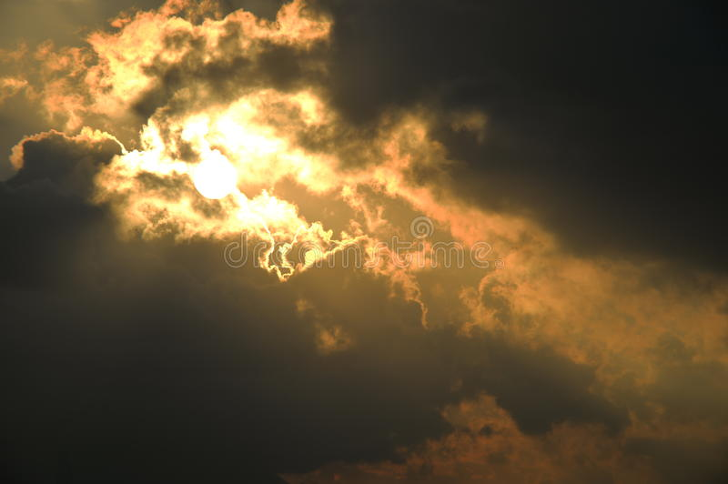 Burned cloud with Sun. Sun finally appear among the clouds weakly stock photography