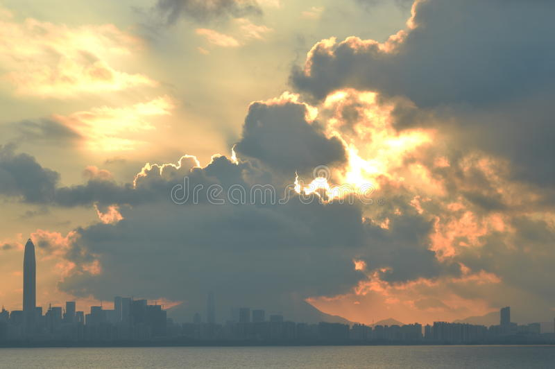 Burned cloud with sunrise. With sun rising higher, the cloud started to be highly burned royalty free stock photo