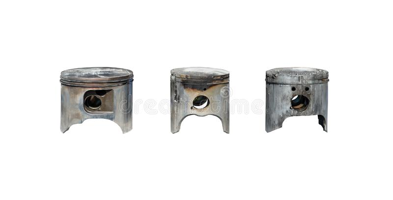Burned, damaged car pistons. Isolated on a white background with a clipping path. stock photography