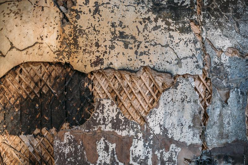 Burned and damaged old dirty grungy wood and cement wall texture surface of ruined house stock images