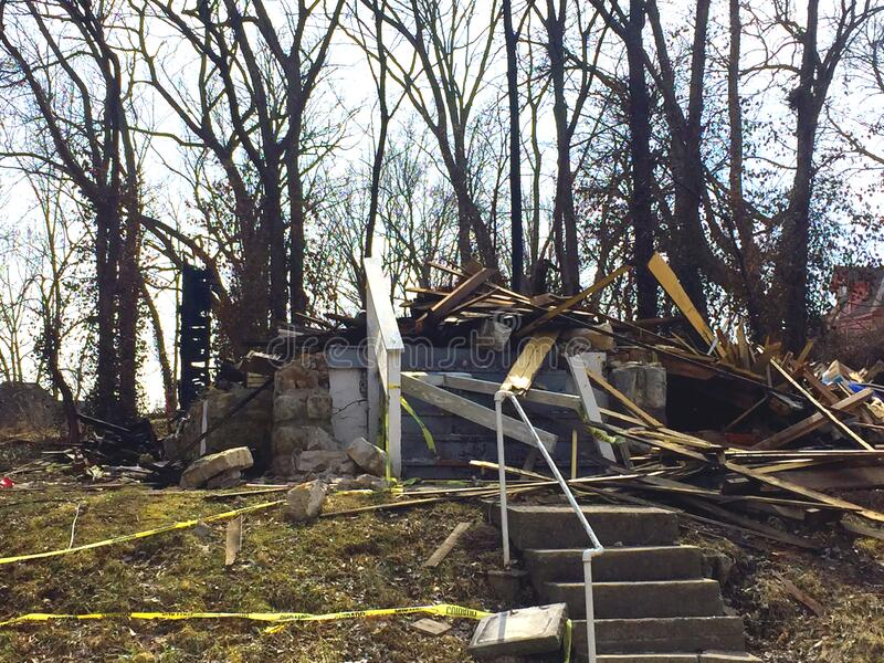 Demolished and burned house. stock images