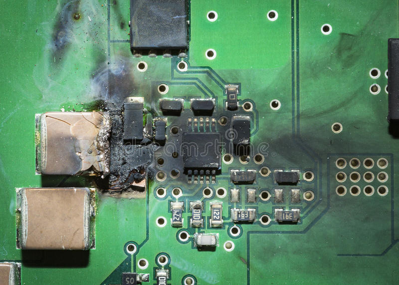 Burned electronic SMD printed circuit board PCB after a short circuit royalty free stock image