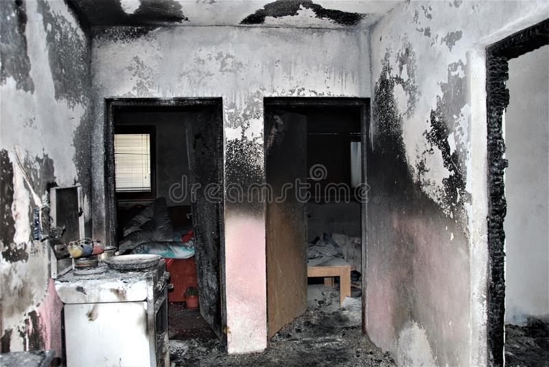 Burned house: hallway and rooms. Indoor: house inside after fire stock image