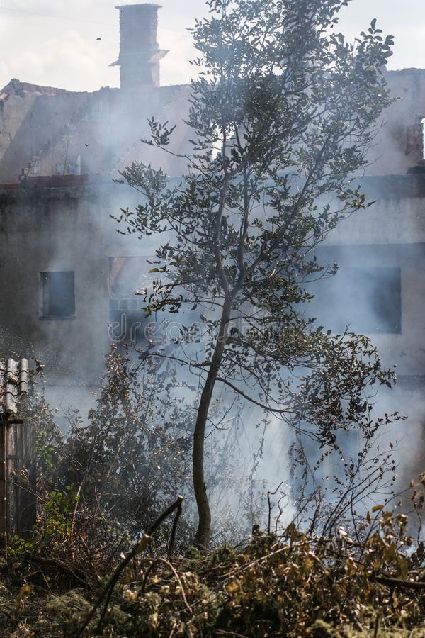 Burned house because of negligence. Burned house in an unknown village caused by human negligence stock photos