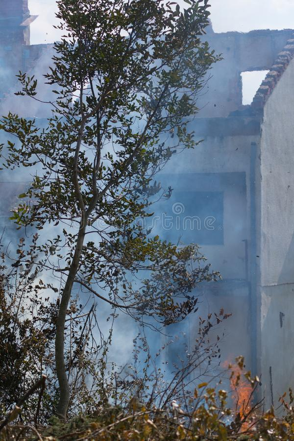 Burned house because of negligence. Burned house in an unknown village caused by human negligence royalty free stock photo