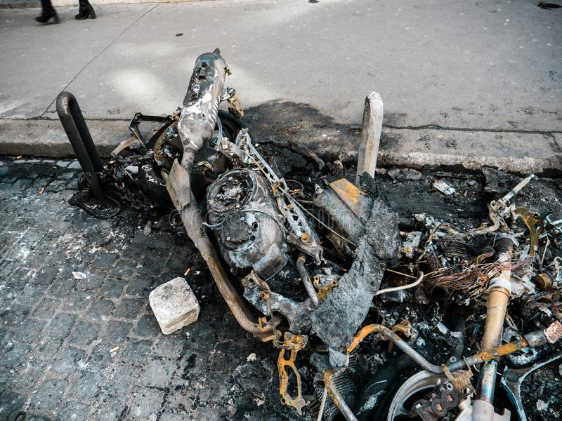 Burned luxury sport motorcycle in Paris France Champs Elysees royalty free stock image