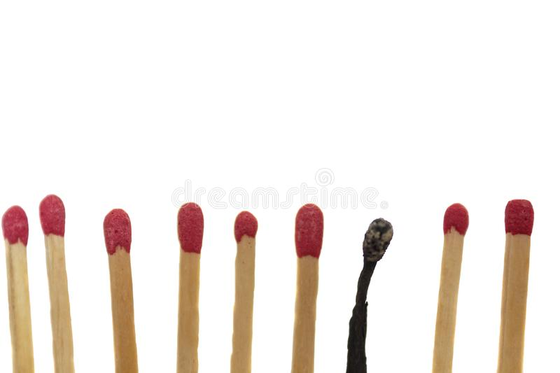 Burned match next to new matches. Burnout concept royalty free stock photos