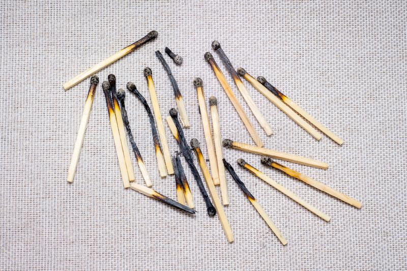 Burned matches on a light background. Used, unnecessary things_. Burned matches on a light background. Used, unnecessary things stock image