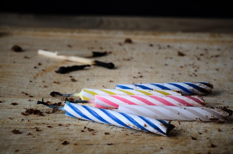 Burned Out Birthday Candles and Matches with Chocolate Cake Crumbs stock photography