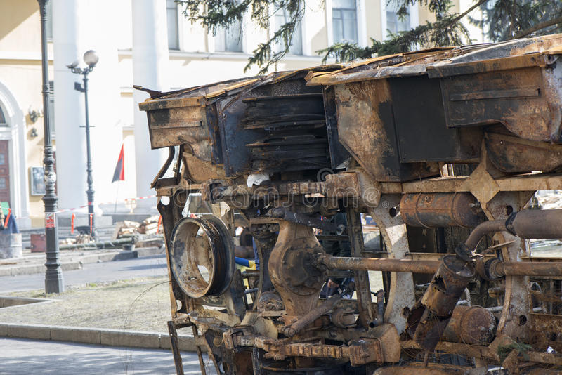 A burned-out car. Barricades in Kiev at the mass unrest during the political crisis in Ukraine. Kiev, 07.03.2014 year royalty free stock images