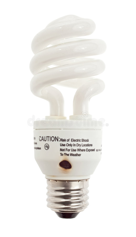 Burned out CFL bulb showing melted casing. Compact fluorecscent bulb showing burn mark due to the activation of the Voltage Dependent Resistor - VDR - caused by royalty free stock photos
