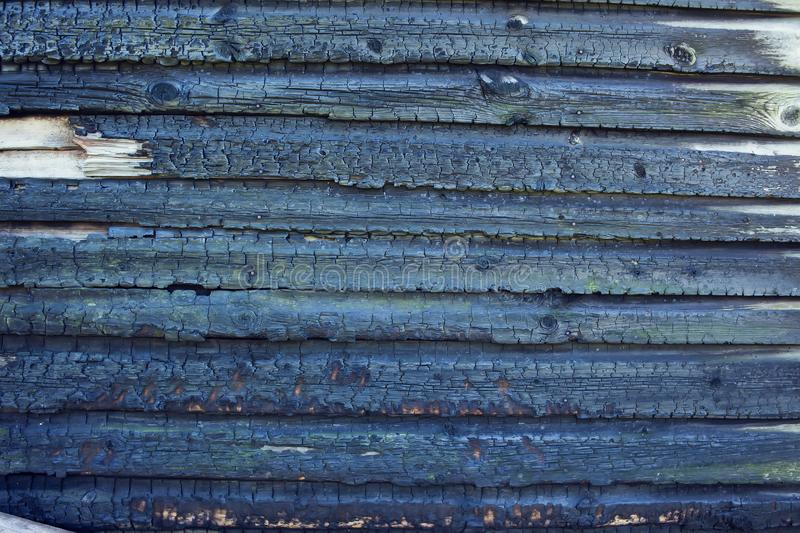 Burned wooden wall background stock photo