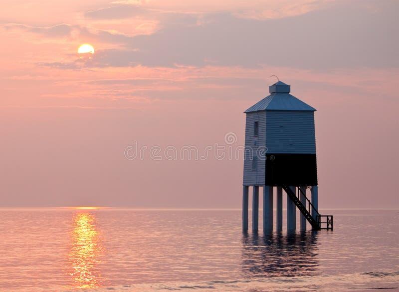 Burnham no mar - farol durante o por do sol fotografia de stock
