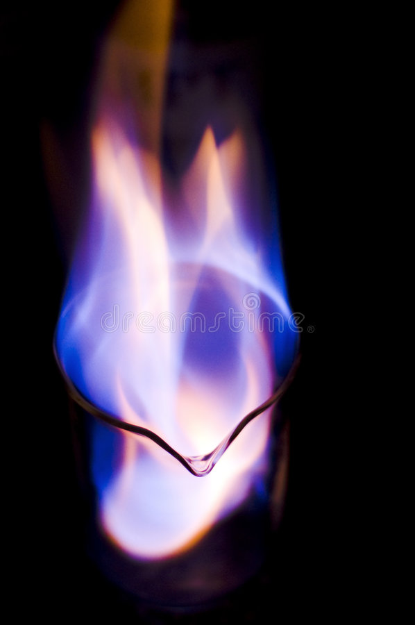 Burning alcohol in flask royalty free stock image