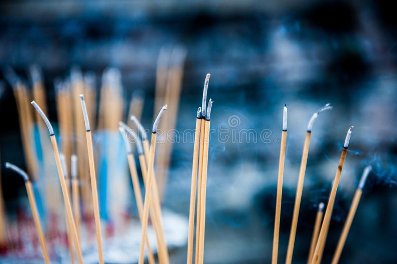 Burning aromatic incense sticks. Incense for praying Buddha or Hindu gods to show respect. Joss stick or incense sticks burning royalty free stock photos