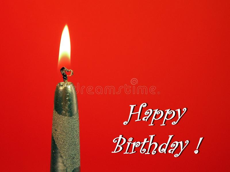 Burning silver candle - Happy Birthday card. Burning beautiful candle on red background - Happy Birthday card stock images
