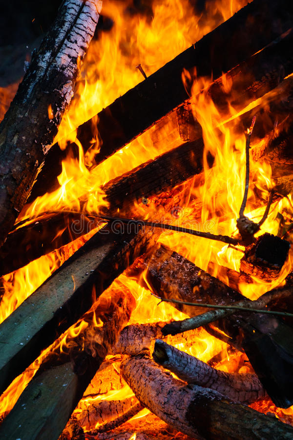 Burning Bonfire. Burning fire with interlaced planks of wood forming triangle patterns stock images