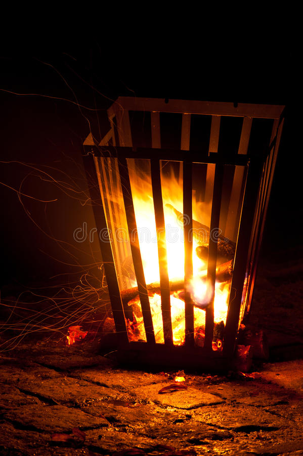 Burning brazier. On stone at night stock photos