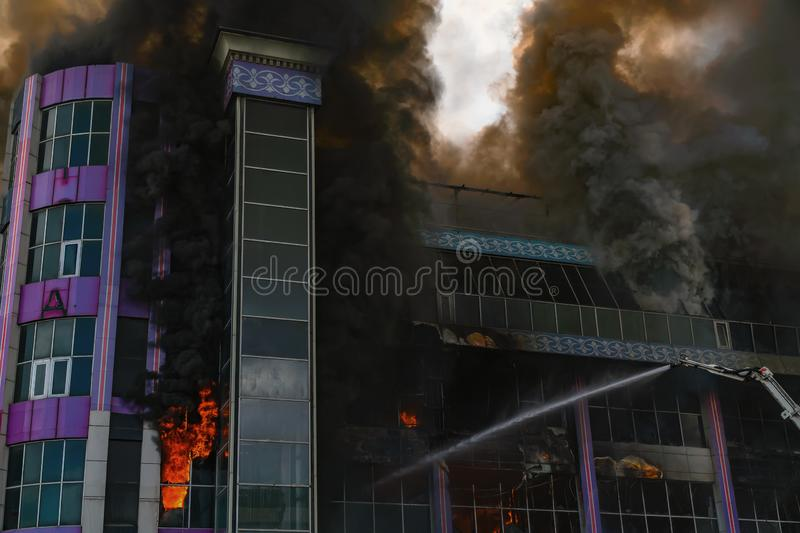 Burning building in thick toxic smoke. Big fire royalty free stock photography