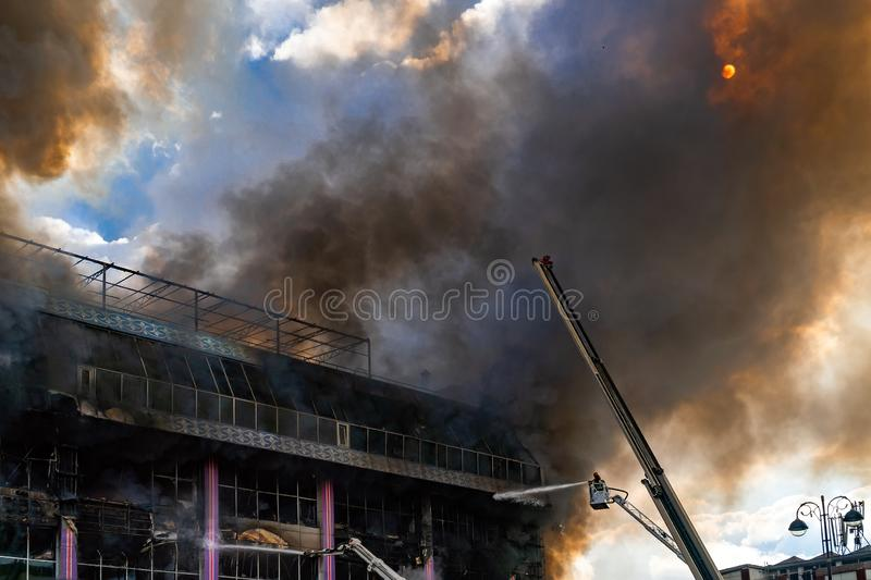 Burning building in thick toxic smoke. Big fire royalty free stock photos