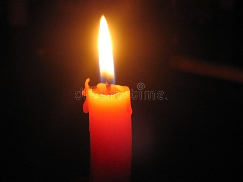 Burning candle. Melting wax, close-up view stock photo