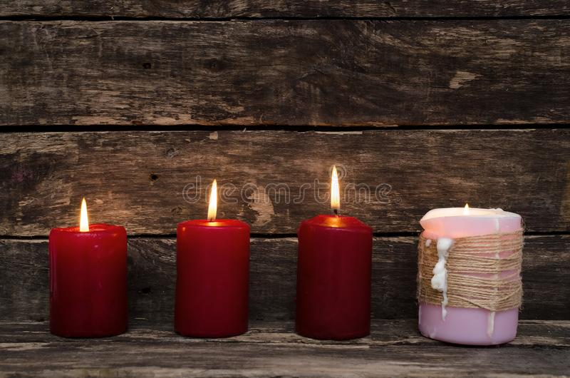 Burning candle on the table. stock images