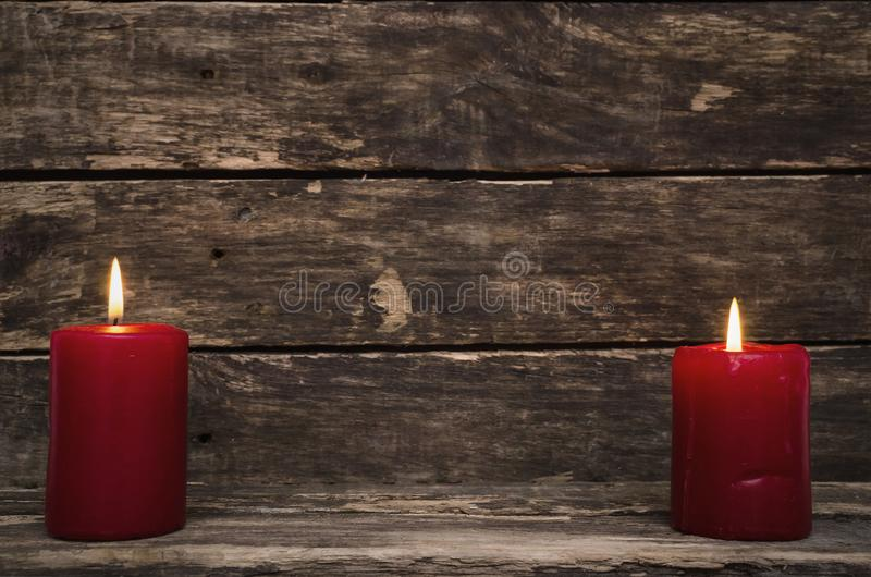 Burning candle on the table. stock image