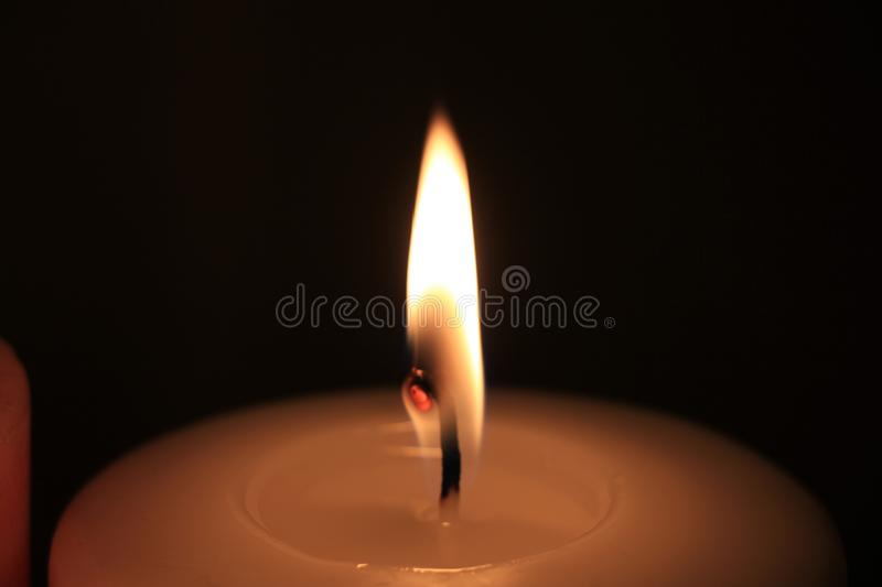 Burning candle in closeup royalty free stock images