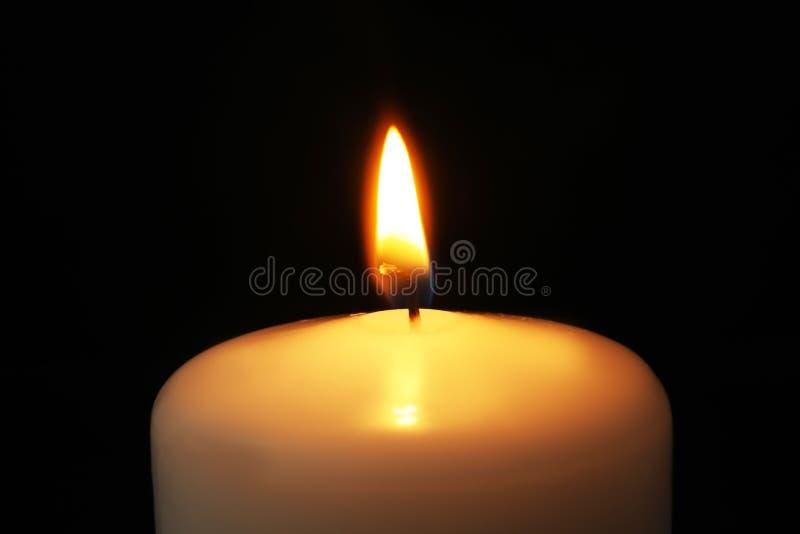 Burning candle on dark background, closeup. Symbol of. Sorrow stock photos