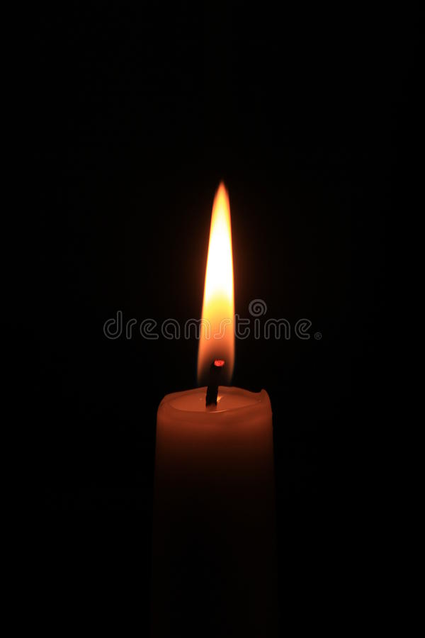 Burning candle in the dark royalty free stock image