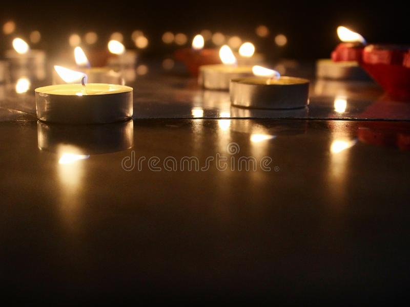 Burning candle for diwali festival. These are the candles lit for the diwali festival which brings joy and spreads enlightment everywhere. Candles are lit in stock photography