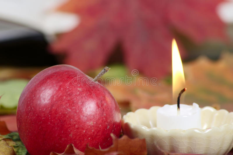 Burning Candle With A Red Apple Royalty Free Stock Photos