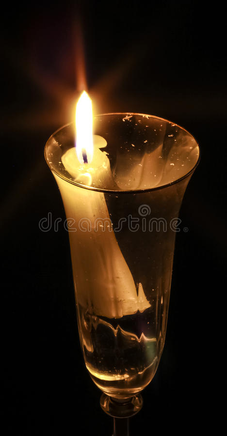 Download Burning Candle Set In A Glass Of Clear Liquid Stock Photo - Image: 83711710