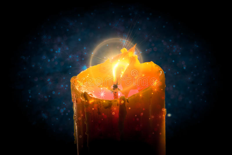 Burning candle with star bokeh and circle flare stock photography