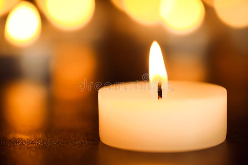 Burning candle on table, closeup. Funeral symbol royalty free stock photos