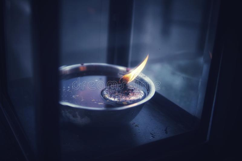 Burning candle tea lights. Burning candle tea lights in Thai temple royalty free stock photo