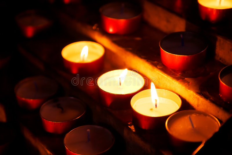 Burning candles. In a church stock image