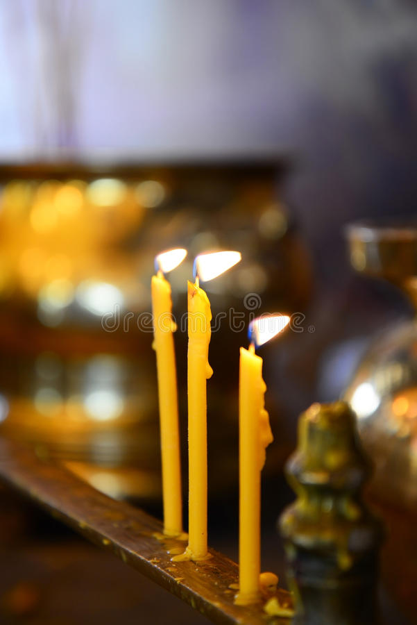 Burning candles Buddha Statue royalty free stock photos