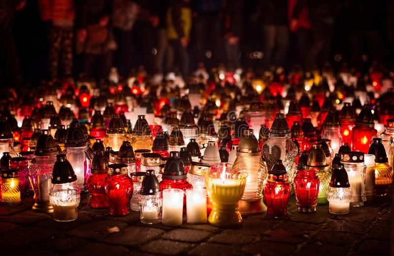 Burning candles at a cemetery during All Saints Day. 1st November stock photo