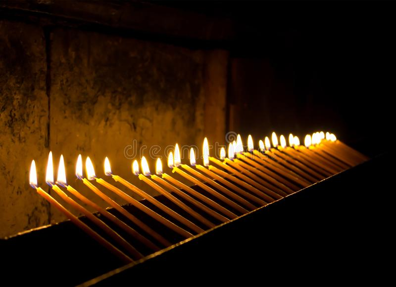 Burning candles in the temple stock image
