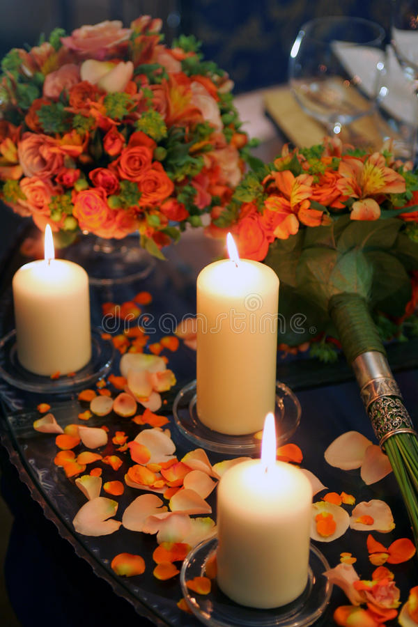Burning Candles Flowers And Petals Royalty Free Stock Photos