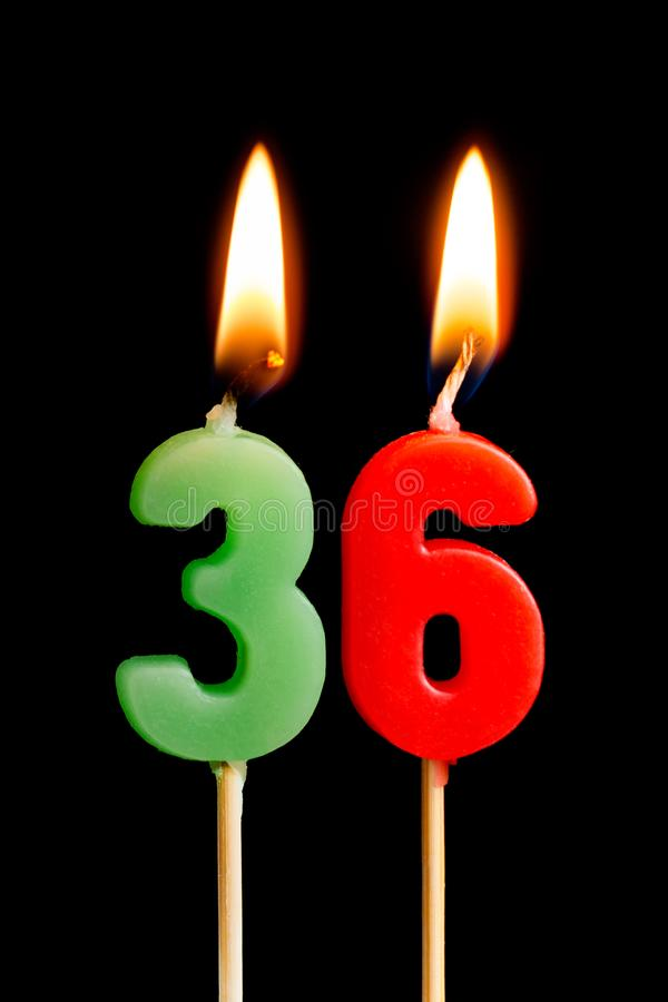 Burning candles in the form of 36 thirty six numbers, dates for cake isolated on black background. The concept of celebrating a. Birthday, anniversary royalty free stock images